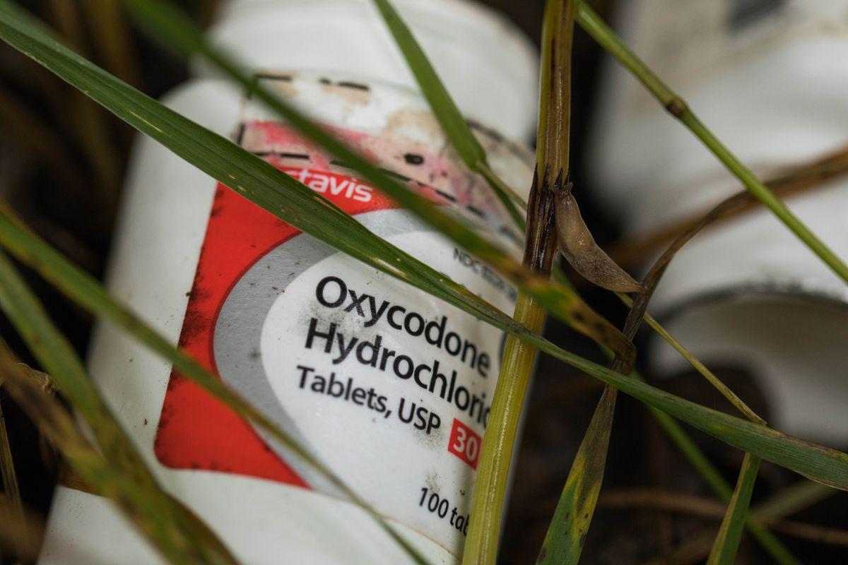 Empty opioid bottles lie discarded in Midtown Anchorage Tuesday, Aug. 29, 2017. (Loren Holmes / Alaska Dispatch News)
