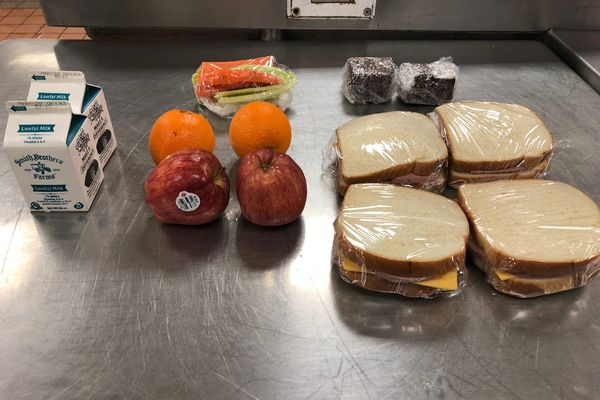 Two options for Ramadan sack meals are pictured in the kitchen of the Anchorage Correctional Complex. The photos show what the Department of Corrections says is a daily portion of food given to an inmate observing Ramadan: Two milk portions, four fruits, two veggie bags, turkey bologna sandwiches and two pieces of cake. (Photo provided by the Department of Corrections)