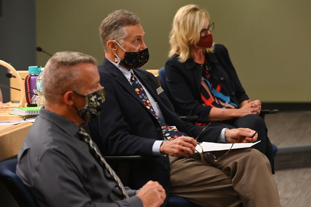 From left, ASD Chief Operating Officer Tom Roth, Deputy Superintendent Dr. Mark Stock and Superintendent Dr. Deena Bishop listen to ASD School Board President Elisa Vakalis speak during an overview of the school start plan on Thursday, July 9, 2020. (Bill Roth / ADN)