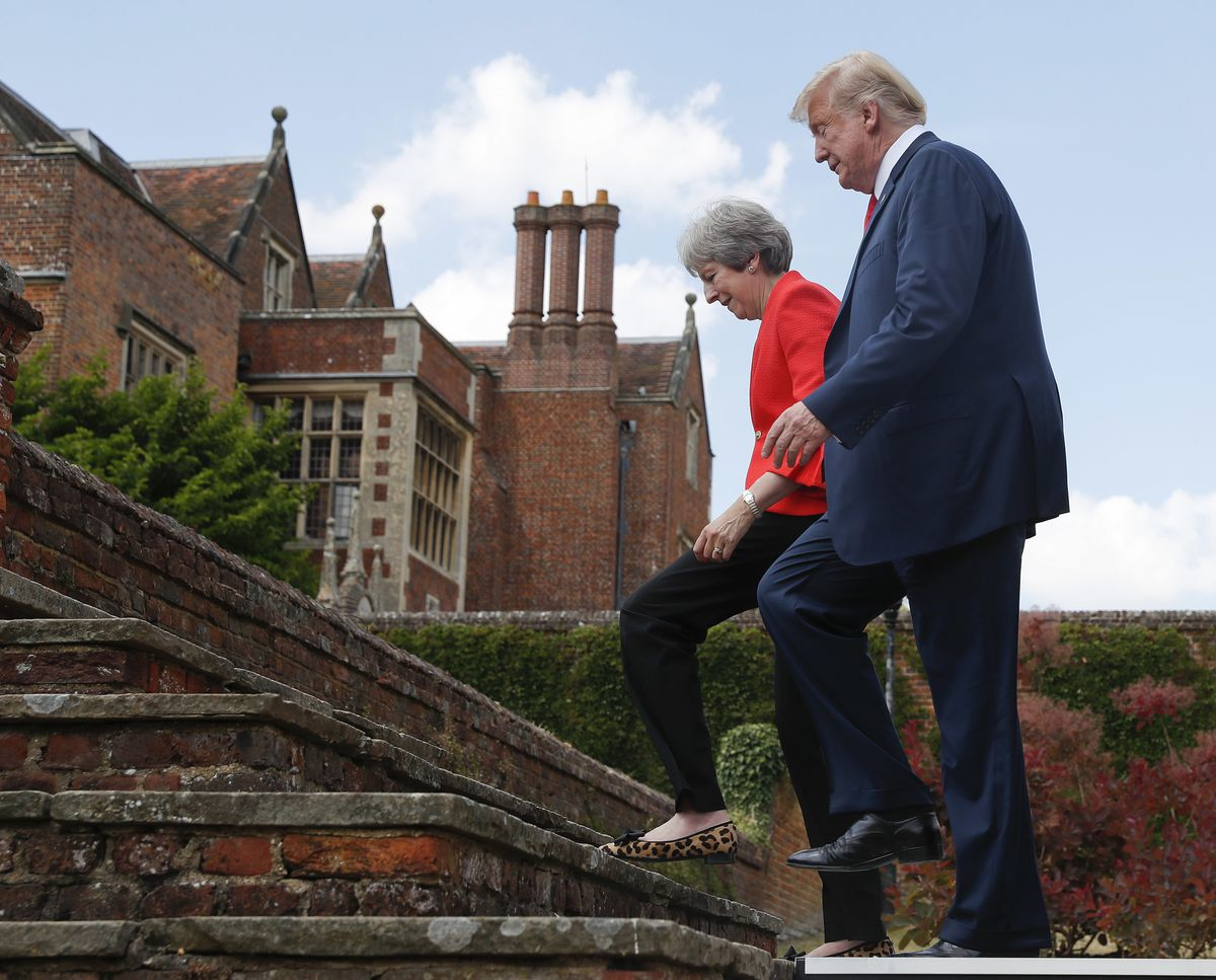 President Donald Trump with British Prime Minister Theresa May walk back together at the conclusion of their joint news conference at Chequers, in Buckinghamshire, England, Friday, July 13, 2018. (AP Photo/Pablo Martinez Monsivais)