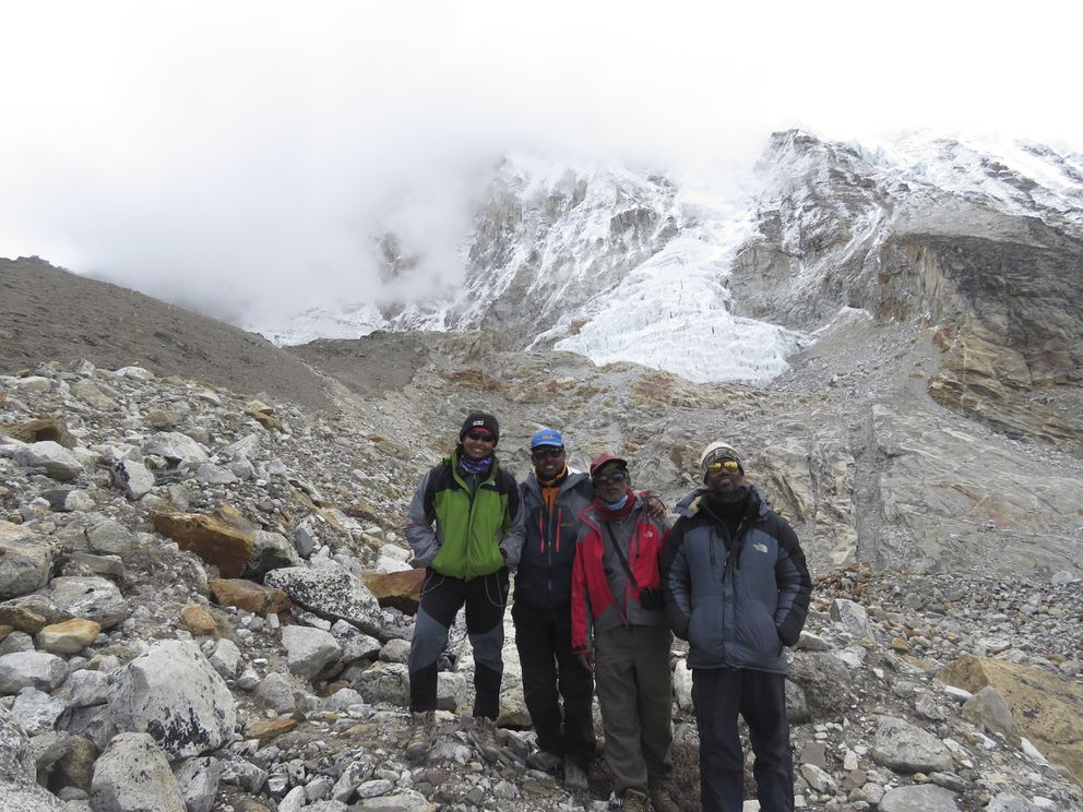 In a handout photo, Sunita Hazra, from left, Goutam Ghosh, Paresh Nath and Subhas Paul on Mount Everest during their 2016 trip. Sherpas took on a quest to find the bodies of climbers Ghosh and Nath — a year after they were abandoned near the top of Everest — and bring them home. (Sunita Hazra via The New York Times)
