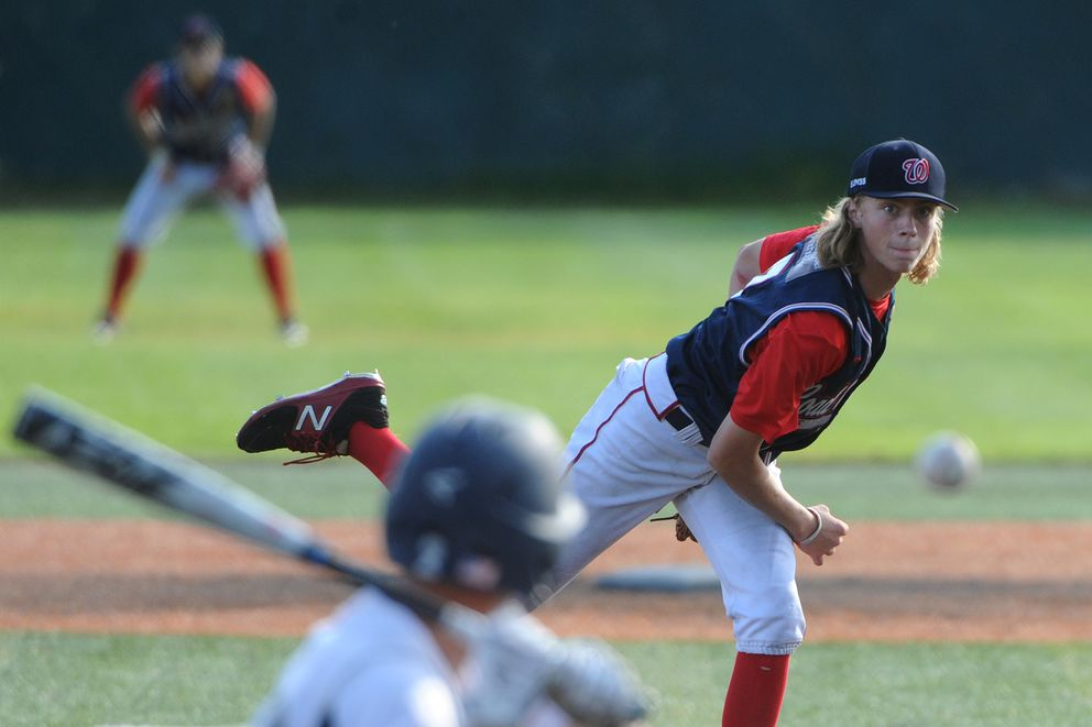 Wasilla pitcher Jacob Gilbert watches the ball while pitching to Juneau batter Riley Griffin. (Bill Roth / ADN)
