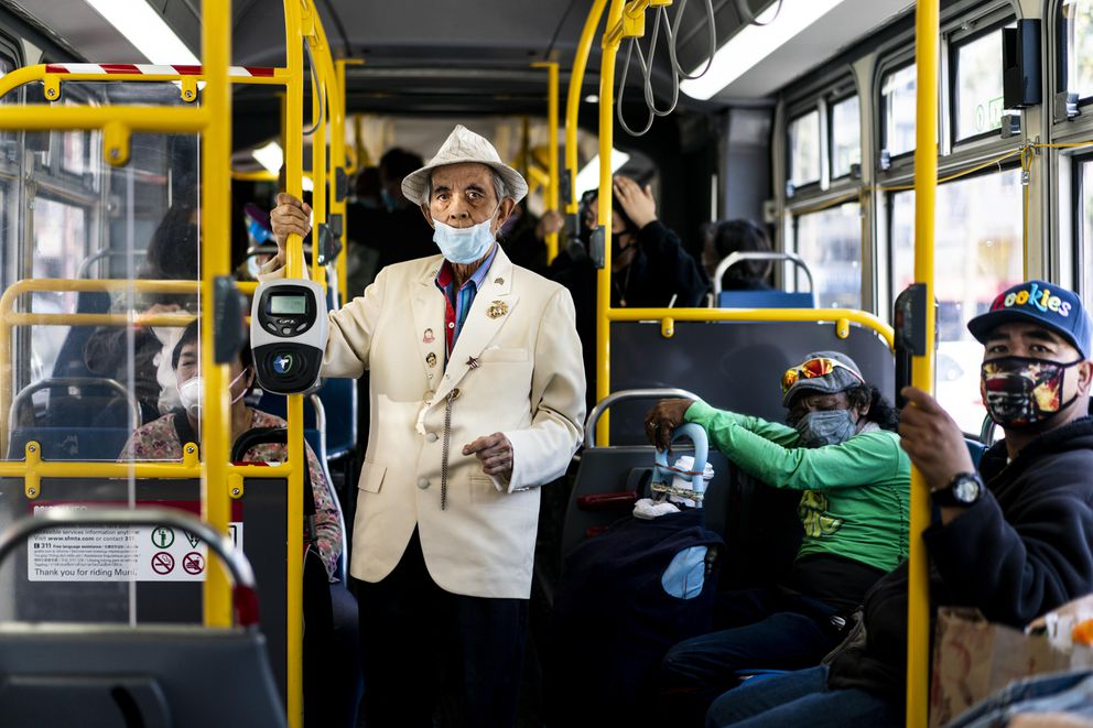 San Franciscans ride a MUNI transit bus through the Mission neighborhood in San Francisco on July 14, 2020. Washington Post photo by Melina Mara