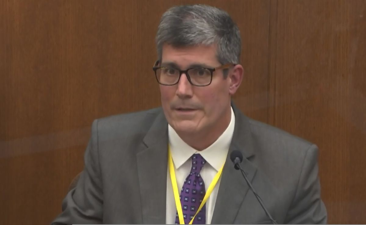 In this image from video, Dr. Andrew Baker, Hennepin County Medical Examiner, testifies Friday in the trial of former Minneapolis police Officer Derek Chauvin at the Hennepin County Courthouse in Minneapolis, Minn. (Court TV via AP, Pool)