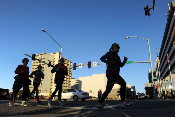 Runners negotiate the course through downtown Anchorage during a Tuesday Pub Run earlier this year.