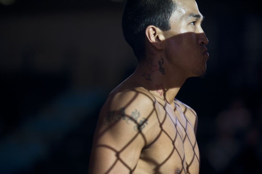 Marv Alexie enters the cage for his fight against Joshua Farmer. Alaska Fighting Championship began its season on September 19, 2018, at the Alaska Airlines Center. (Marc Lester / ADN)