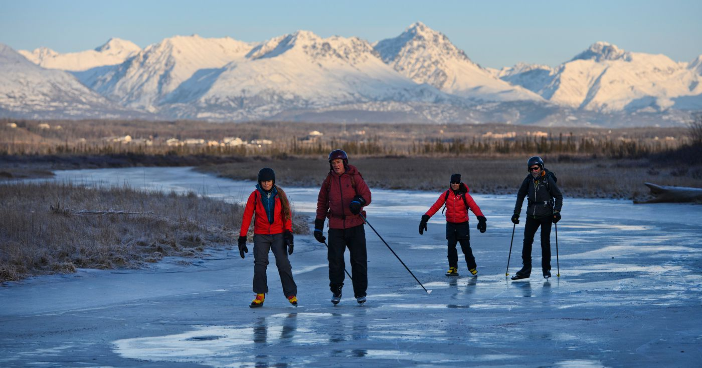 Dori McDannold, John Fowler, Amy Dalton and Paul Twardock skate on a waterway across Palmer Hay Flats State Game Refuge on December 17, 2019. (Marc Lester / ADN)