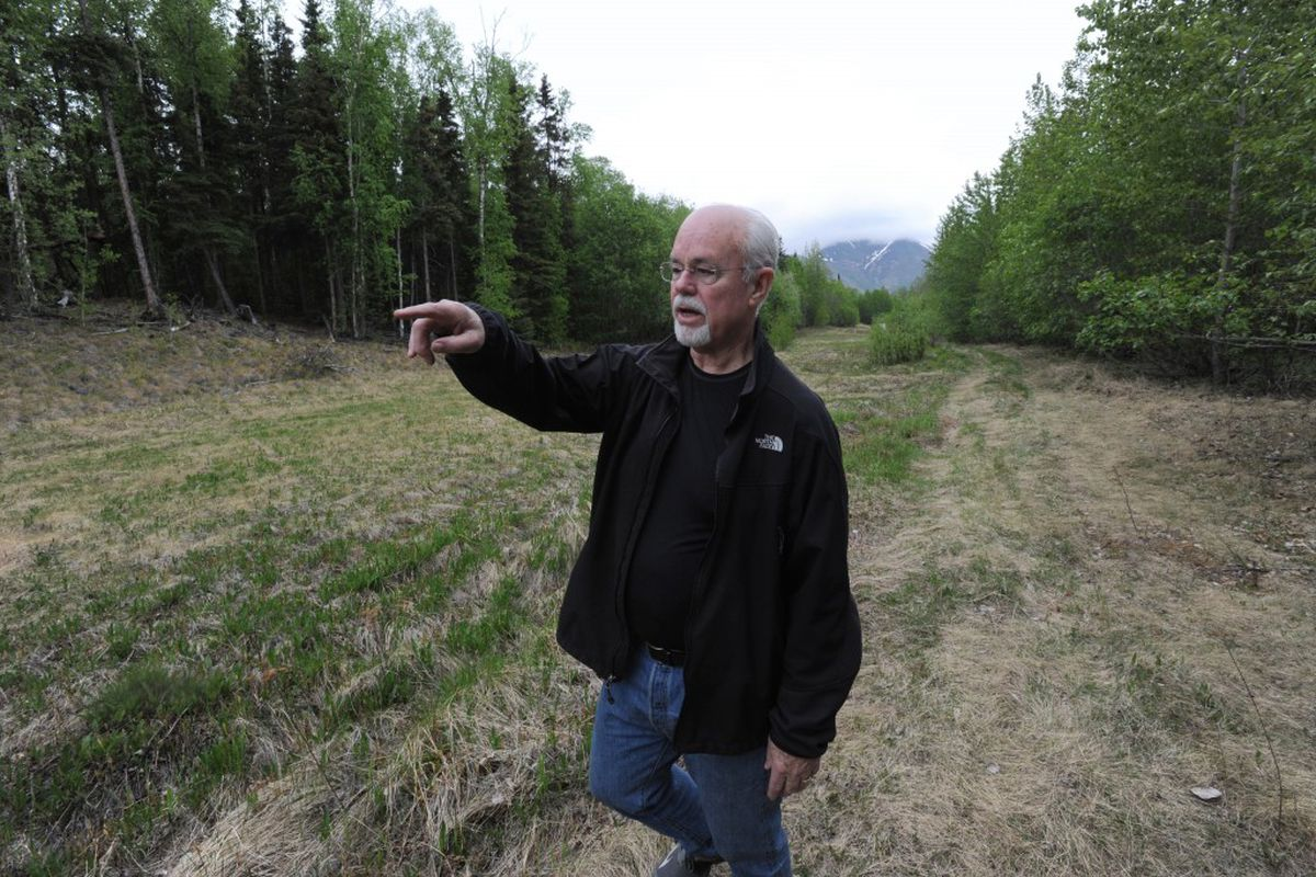 Ric Davidge, chairman and CEO of the Alaska Veterans Foundation, looks at land in Eklutna on May 18, 2016, where he would like to lease and build a cabin village for homeless veterans. (Bill Roth / Alaska Dispatch News)
