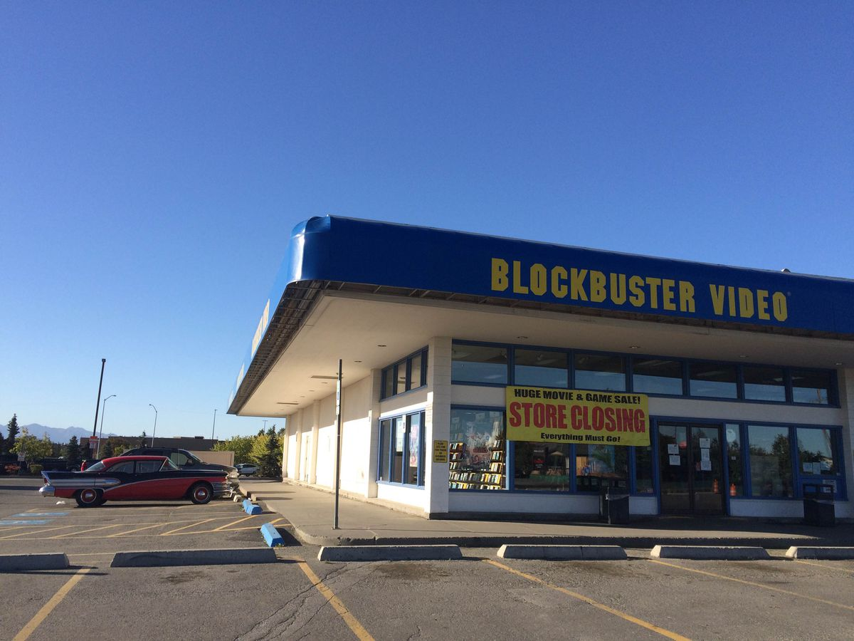 "A ""store closing"" sign hangs outside a Blockbuster video on Northern Lights Boulevard in Midtown Anchorage on Tuesday, Aug. 30, 2016. The store is one of only a handful of Blockbusters around the country that remain open, including several in Alaska. (Annie Zak / Alaska Dispatch News)"