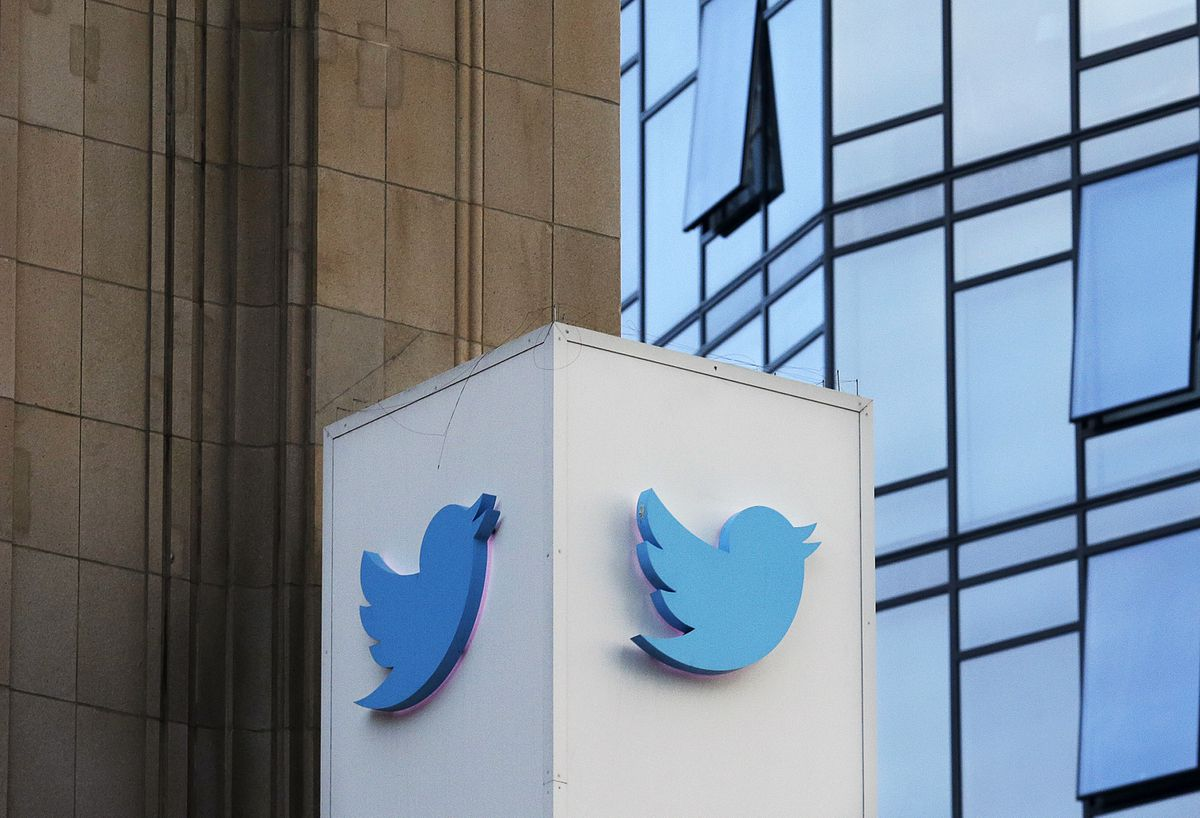 FILE - This Oct. 26, 2016 file photo shows a Twitter sign outside of the company's headquarters in San Francisco. Facebook and other social platforms have been waging a fight against online misinformation and hate speech for two years. With the U.S. midterm elections coming soon on Tuesday, Nov. 6, 2018, there are signs that they're making some headway, although they're still a long way from winning the war. (AP Photo/Jeff Chiu, File)