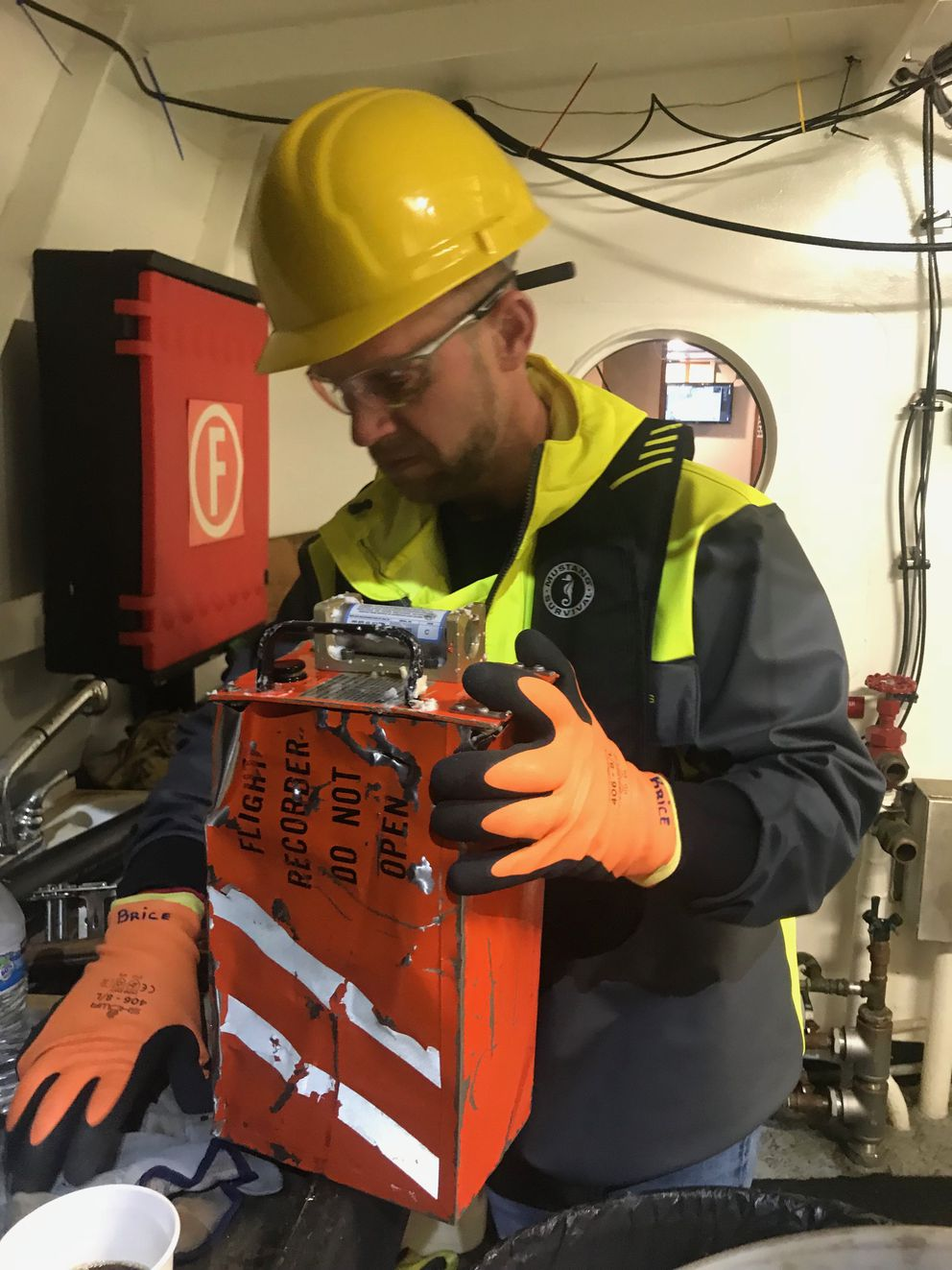NTSB investigator Brice Banning holds a flight recorder from a Beechcraft B200 that was recovered from the ocean waters of Frederick Sound near Kake. (NTSB photo)