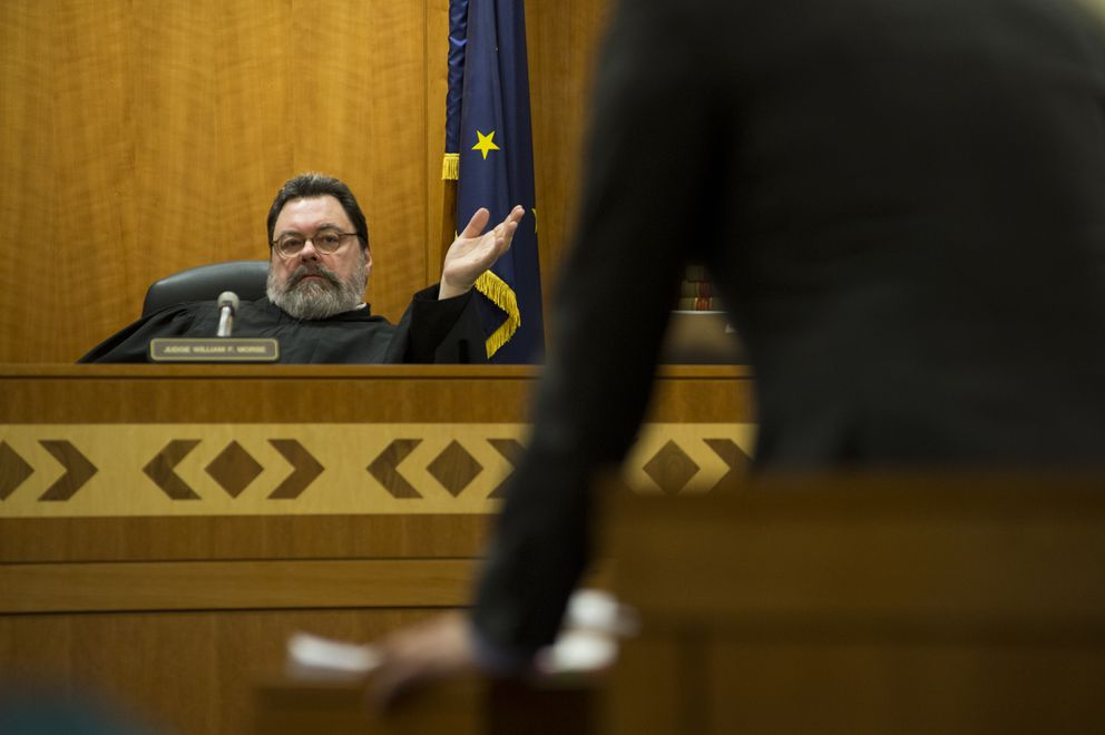 Judge William Morse speaks with an attorney Monday during a calendar hearing on March 5, 2018. (Marc Lester / ADN)