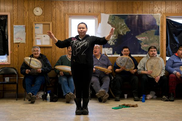 Rosina Toolie, 29, is one of the first to dance. (Marc Lester / Alaska Dispatch News)