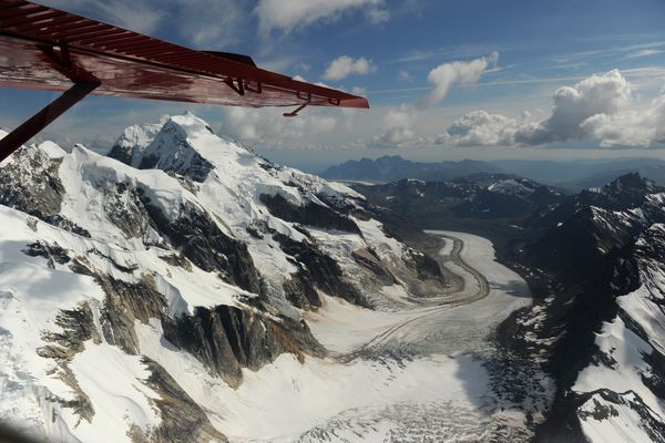 Backside Glacier with Ruth Gorge peaks pass by under the wing as Talkeetna Air Taxi pilot Kris Peterson flies a Beaver airplane on a flightseeing tour of Mount McKinley and the peaks and glaciers on the south side of the mountain on Tuesday, July 21, 2015. Talkeetna Air Taxi is based out of Talkeetna, and flies daily tours of the mountain in Denali National Park.