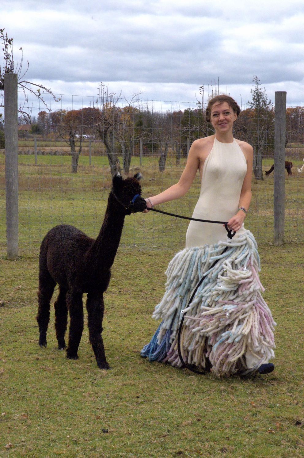 Toronto-based fashion designer Jacquelyn van Kampen models a dress she designed as part of her portfolio while applying for an artist-in-residency position in Haines Junction. Alpaca roving makes up the bottom portion of the gown. (Courtesy Jacquelyn van Kampen)
