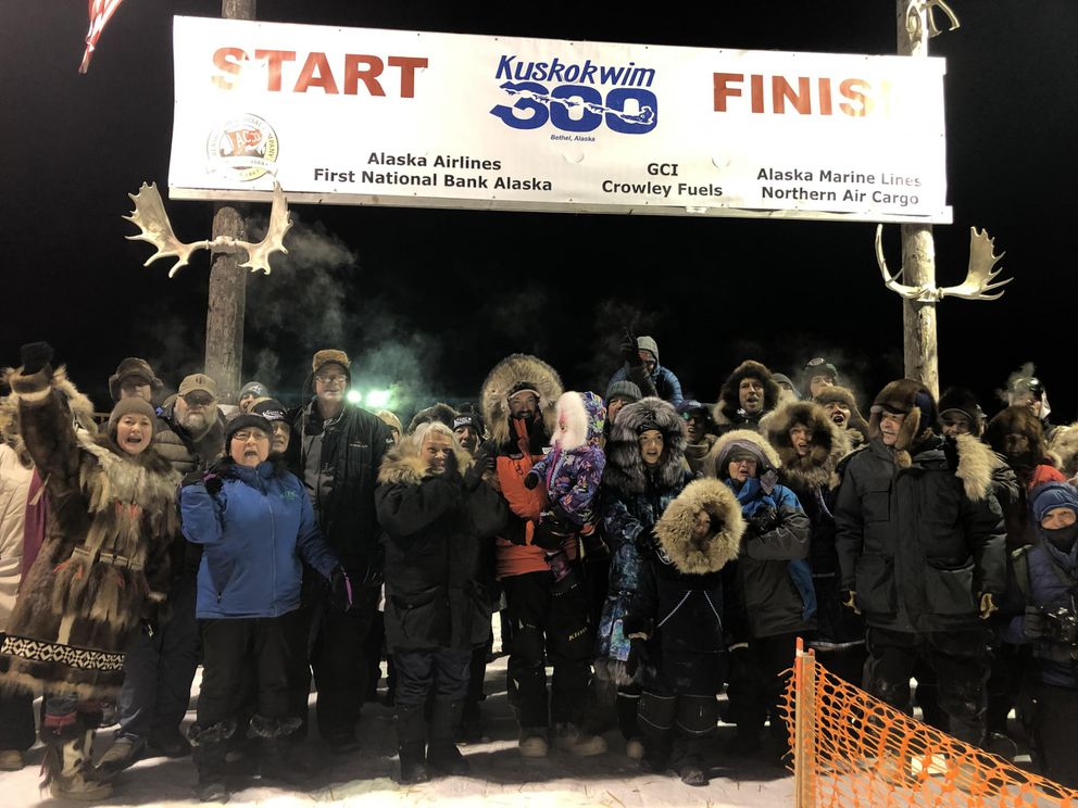 2020 Kuskokwim 300 champion Pete Kaiser celebrates with friends and family after notching his fifth win. (Katie Basile / KYUK Public Media)