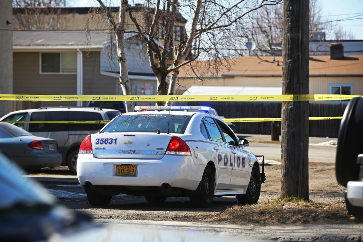 Anchorage police respond to a scene at the 1000 block of Ingra Street in Anchorage on Friday. (Emily Mesner / ADN)