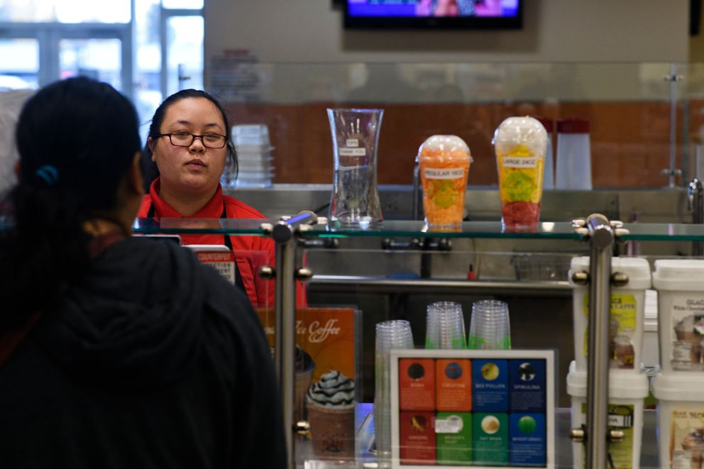 Cindy Lee talks with a customer at the FruitLand Fresh smoothie stand at the Midtown Mall on October 2, 2018. (Marc Lester / ADN)