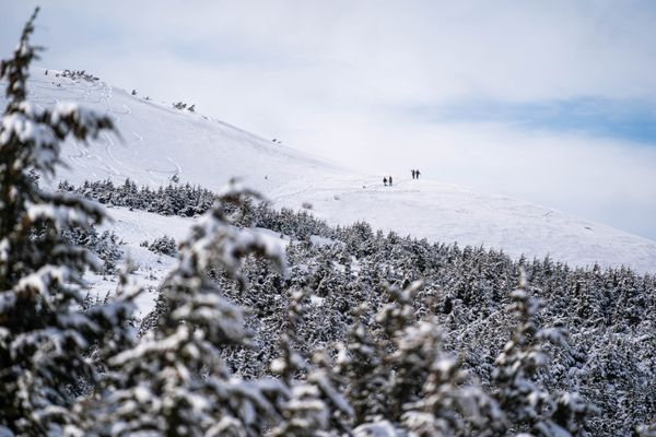 People hike on Blueberry Hill in Glen Alps on Saturday, April 4, 2020 in Anchorage. (Loren Holmes / ADN)