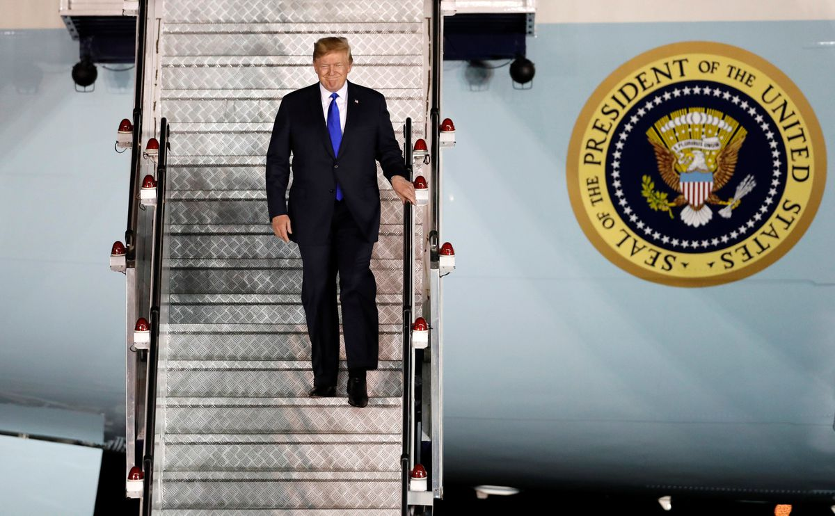 U.S. President Donald Trump steps off his plane as he arrives at Paya Lebar Air Base in Singapore, ahead of a summit with North Korean leader Kim Jong Un, June 10, 2018. REUTERS/Kim Kyung-Hoon