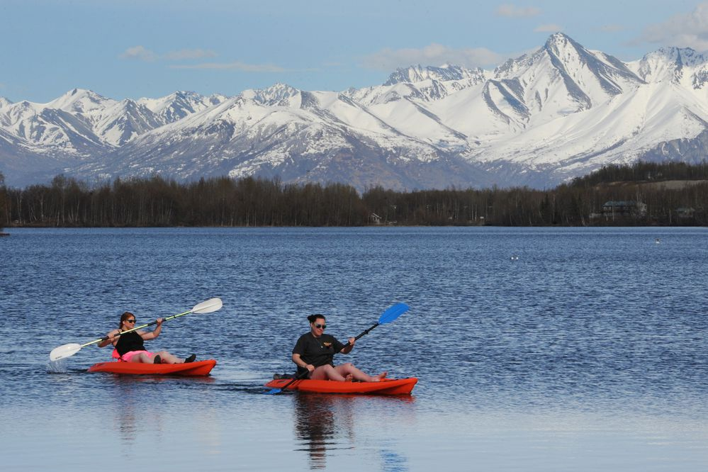 Jennifer Barlow, left, and Carrie Jelle return to Newcomb Park after paddling kayaks for a couple hours on Wasilla Lake during a 64-degree day on Wednesday, May 1, 2019. (Bill Roth / ADN)