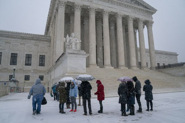 Visitors wait to enter the Supreme Court as a winter snow storm hits the nation's capital making roads perilous and closing most Federal offices and all major public school districts, on Capitol Hill in Washington, Wednesday, Feb. 20, 2019. (AP Photo/J. Scott Applewhite)