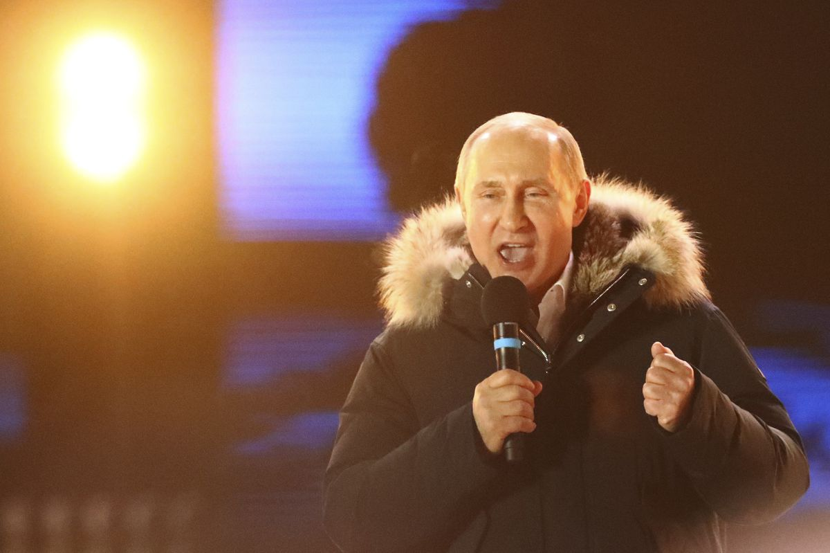 Russian President and Presidential candidate Vladimir Putin delivers a speech during a rally and concert marking the fourth anniversary of Russia's annexation of the Crimea region, at Manezhnaya Square in central Moscow, Russia March 18, 2018. REUTERS/David Mdzinarishvili