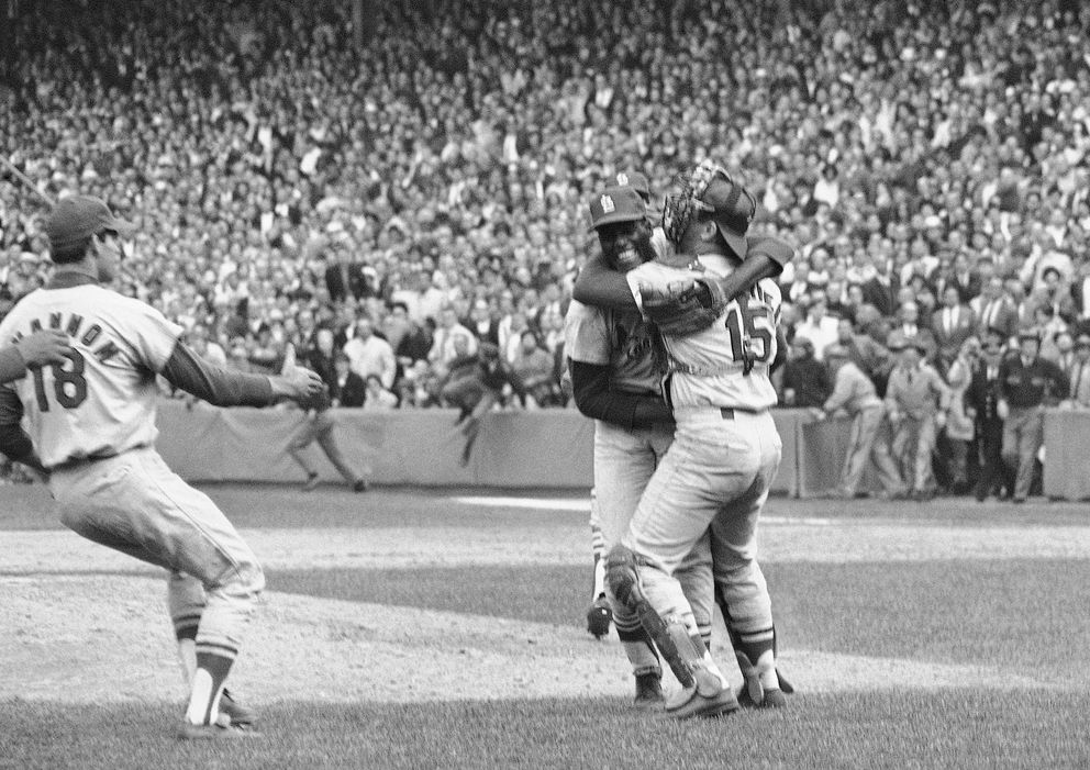 FILE - In this Oct. 12, 1967, file photo, St. Louis Cardinals pitcher Bob Gibson receives a congratulatory hug from catcher Tim McCarver after he pitched a three-hitter in the team's 7-2 victory in Game 7 over the Boston Red Sox to win the World Series at Fenway Park in Boston, Mass. (AP Photo, File)