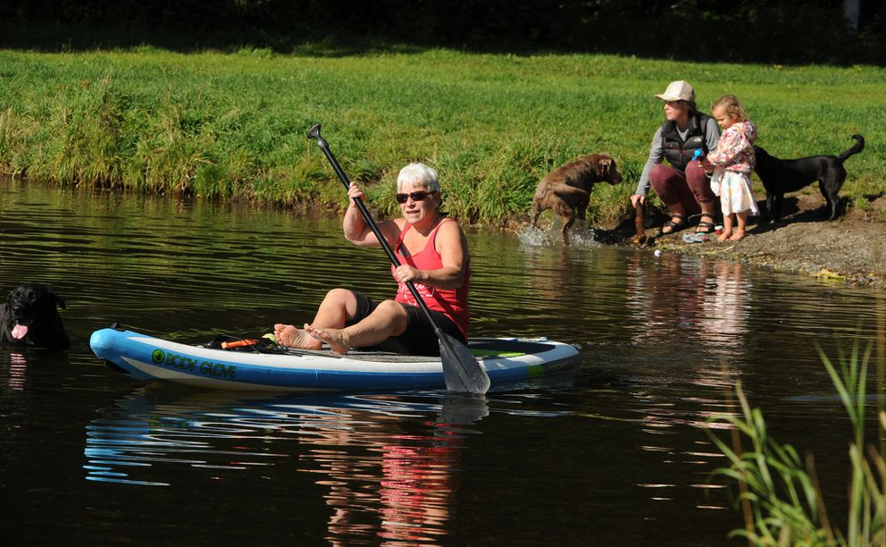 People enjoy the warmth and sunshine on the first day of September at Little Campbell Lake. (Bob Hallinen / ADN)