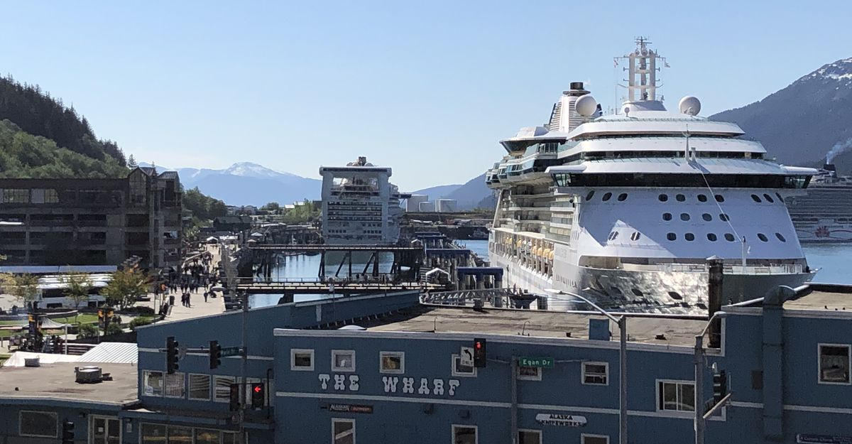 Cruise ships line the docks of the Port of Juneau on Tuesday, May 21, 2019 as tourists walk alongside. (James Brooks / ADN)
