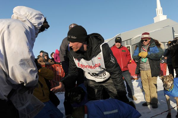 Iditarod musher Dallas Seavey reaches out to shake hands with Nicolas Petit after they finished 2nd and 3rd in the 2017 Iditarod Trail Sled Dog Race on Tuesday, March 14, 2017. (Bob Hallinen / Alaska Dispatch News)