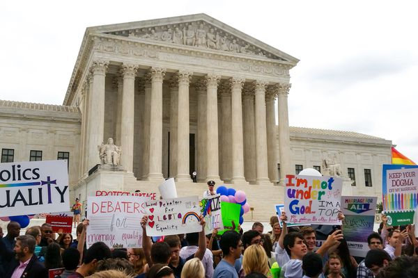 OPINION: It's hard to do a cool legal analysis of the Supreme Court's same-sex marriage decision when that decision is a thunderbolt in your own life. Pictured: Celebrants outside the U.S. Supreme Court on June 26.