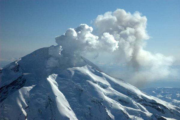 Redoubt volcano spews steam and ash from a crater on its north flank March 15, 2009. Ashfall was limited to the south crater floor, rim, and extending south-southeast.