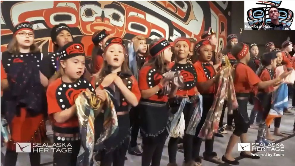 Provided by the Sealaska Heritage Institute, this photo from a Nov. 5, 2020, Zoom memorial service for Tlingit elder David Katzeek, in Juneau, Alaska, shows a 2018 recording of children performing a song written by Katzeek as people honored Katzeek over the internet as the pandemic had made in-person ceremonies impossible. (Sealaska Heritage Institute via AP)