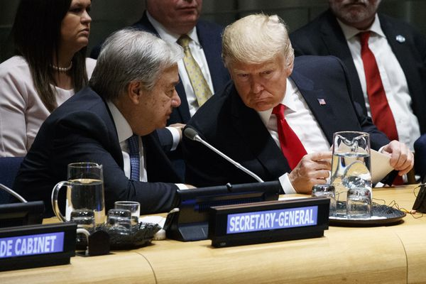 United Nations Secretary General Antonio Guterres, left, talks with President Donald Trump during the