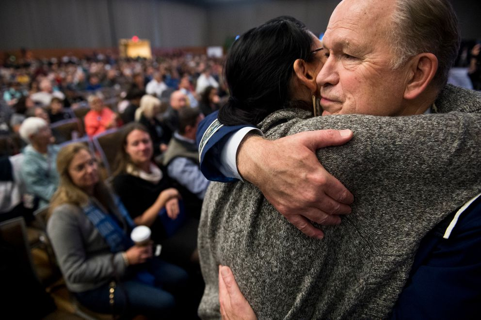 Gov. Bill Walker is hugged by a supporter after he announced that he suspended his campaign for election at the Alaska Federation of Natives annual convention on October 19, 2018. (Marc Lester / ADN)