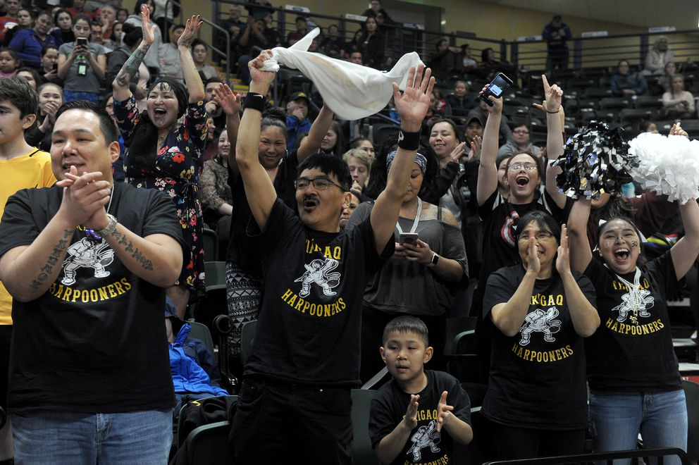 Tikigaq fans celebrate their Class 2A girls state championship last year at the Alaska Airlines Center. (Photo by Bob Hallinen)