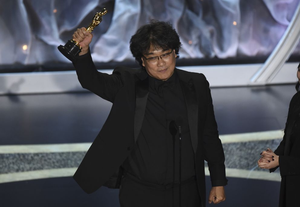 Bong Joon Ho accepts the award for best international feature film for 'Parasite, ' from South Korea, at the Oscars on Sunday, Feb. 9, 2020, at the Dolby Theatre in Los Angeles. (AP Photo/Chris Pizzello)