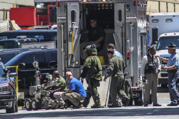 The Atlanta police bomb squad work on the scene after a man lit himself on fire outside the state Capitol in downtown Atlanta, Tuesday, June 26, 2018. The man who says he was disgruntled with the Veterans Affairs system strapped fireworks to his chest and lit himself on fire in front of the Georgia Capitol on Tuesday. (John Spink/Atlanta Journal-Constitution via AP)