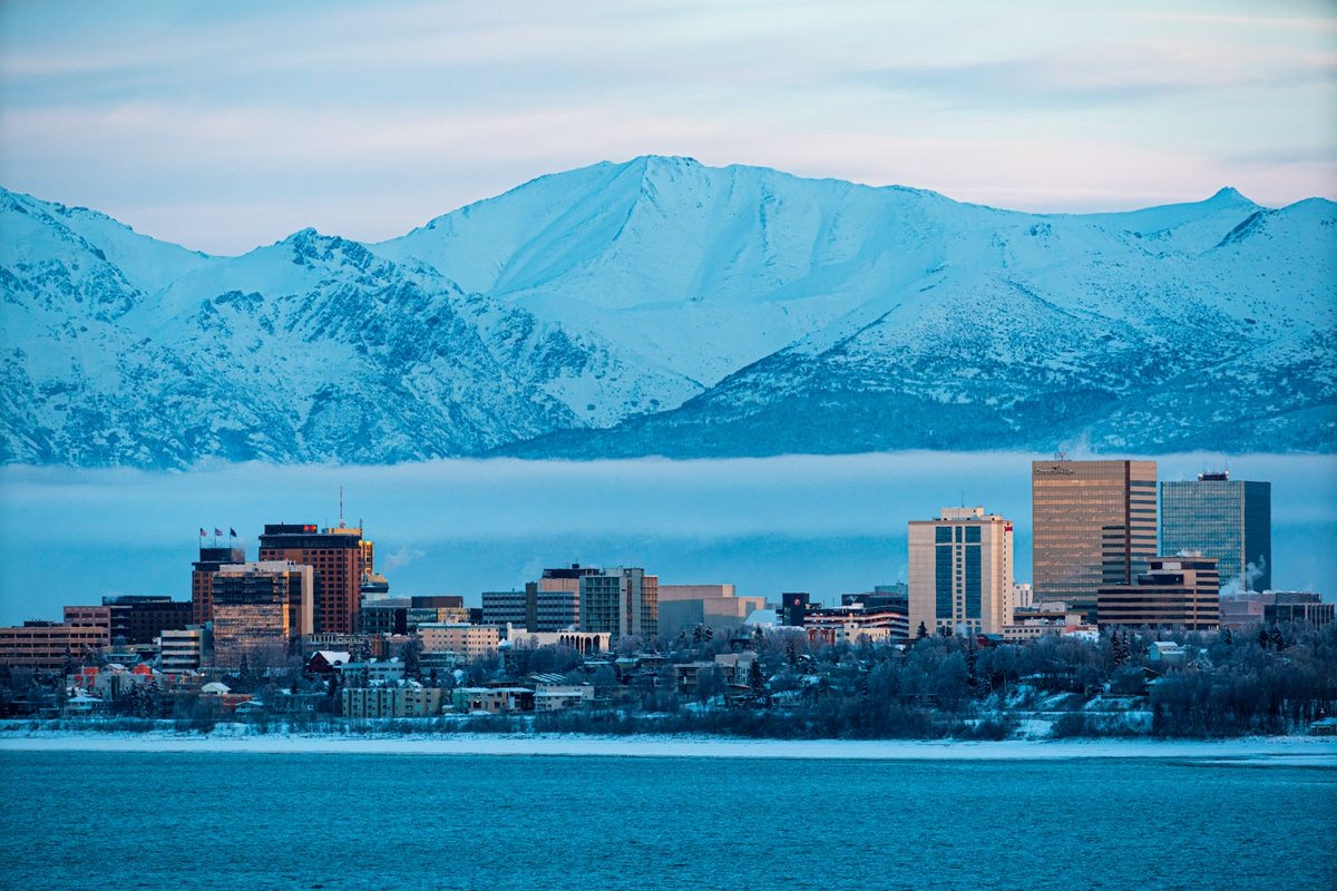 Downtown Anchorage is illuminated by the sunset on Thursday, Dec. 5, 2019 in this view from Earthquake Park. (Loren Holmes / ADN)