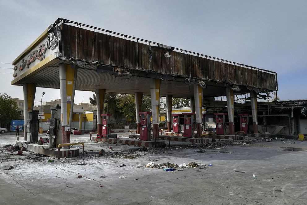 This photo released by the Iranian Students' News Agency, ISNA, shows a gas station that was burned during protests that followed authorities' decision to raise gasoline prices, in Tehran, Iran, Sunday, Nov. 17, 2019. Ayatollah Ali Khamenei, Iran's supreme leader on Sunday backed the government's decision to raise gasoline prices and called angry protesters who have been setting fire to public property over the hike 'thugs, ' signaling a potential crackdown on the demonstrations. (Abdolvahed Mirzazadeh/ISNA via AP)