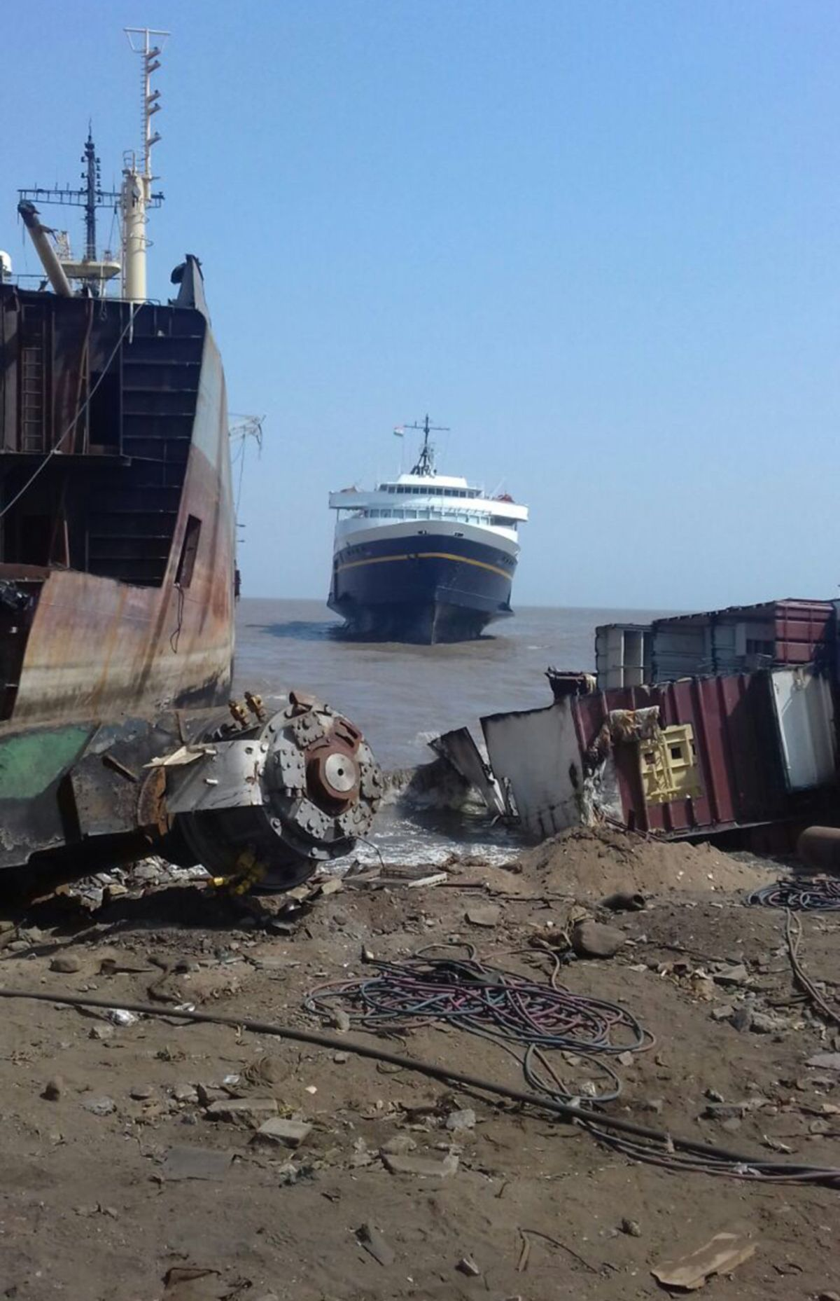 The M/V Taku, which served as a ferry in Alaska for more than a half-century, sits aground at high tide in Alang, India, where it's set to be dismantled for scrap and recycling. The state sold the Taku for $171,000 earlier this year to Jabal Al Lawz Trading Est., which is based in Dubai and sailed the ship across the Pacific. (Ben Evans / Jabal Al Lawz Trading Est.)