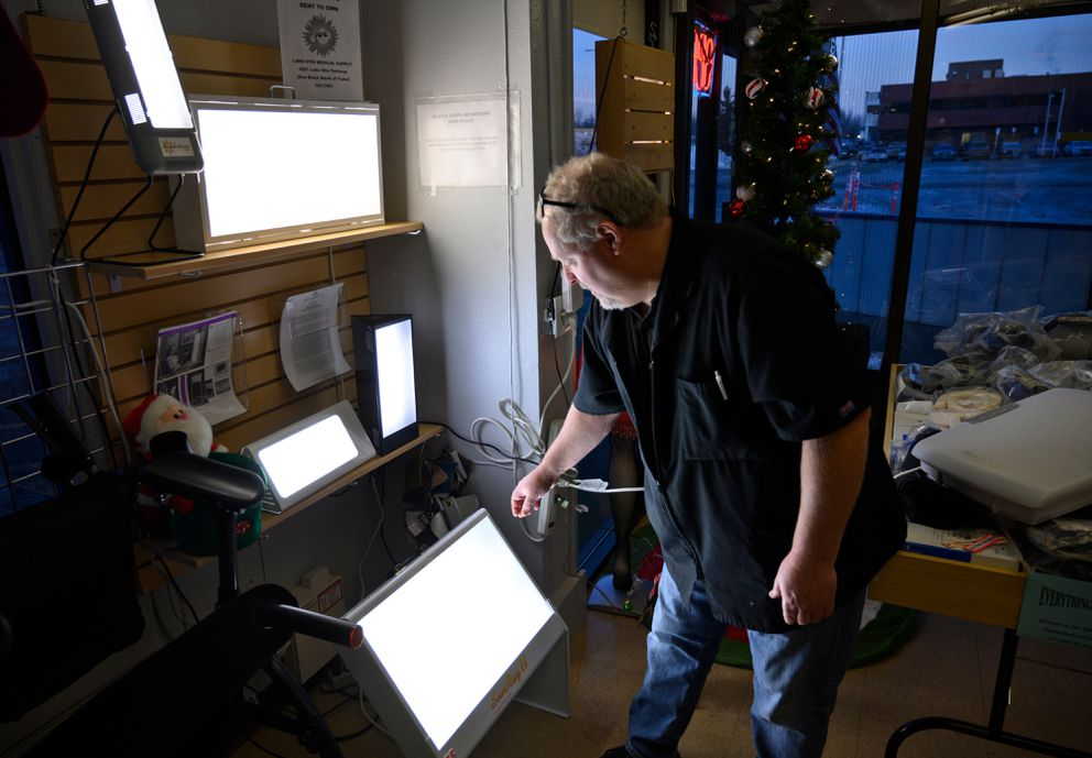Joe Vergnetti shows various S.A.D. therapy lights sold by Lake Otis Medical Supply in Anchorage on December 19, 2019. (Marc Lester / ADN)