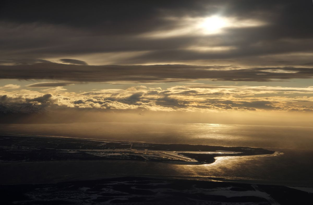 Sun breaks through the clouds to brighten the vicinity of Ted Stevens Anchorage International Airport on January 2, 2019. (Marc Lester / ADN)