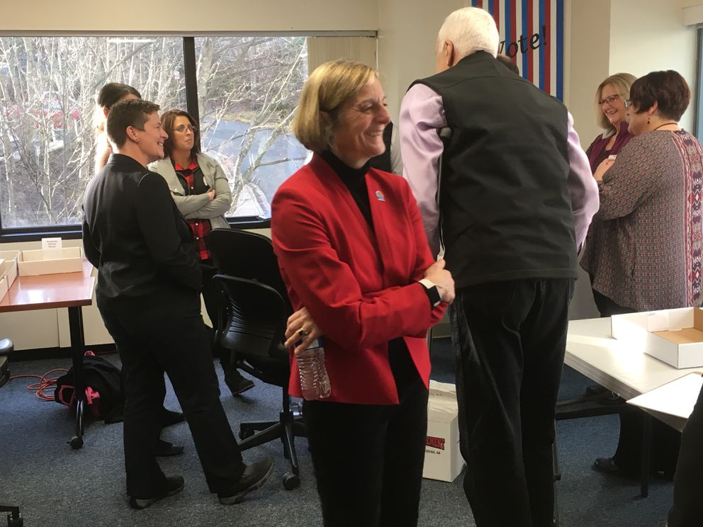 Kathryn Dodge, Democratic candidate for House District 1, smiles after learning she has taken a lead during the recount for her statehouse race Friday, Nov. 30, 2018 at the Alaska Division of Elections office in Juneau. (James Brooks/ADN)