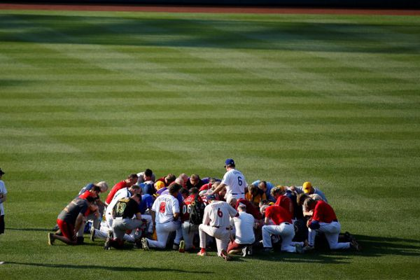 Members of the Republican team pray before the Democrats and Republicans face off in the annual Congressional Baseball Game at Nationals Park in Washington, U.S., June 15, 2017. REUTERS/Joshua Roberts