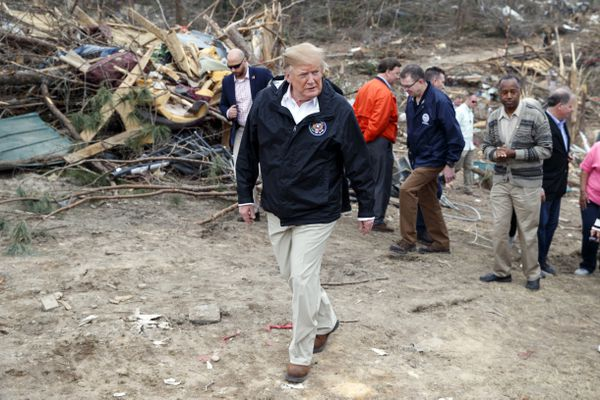 President Donald Trump tours Beauregard, Ala., Friday, March 8, 2019, where tornados killed 23 people in Lee County, Ala. (AP Photo/Carolyn Kaster)
