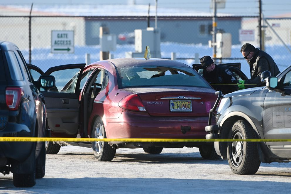Anchorage Police investigate the scene of an early morning officer-involved shooting that occurred during a traffic stop on 5th Avenue at Reeve Circle on Sunday, Feb. 16, 2020. One male was fatally shot after he fired at two officers, police said. One of the officers was wounded by gunfire. (Bill Roth / ADN)
