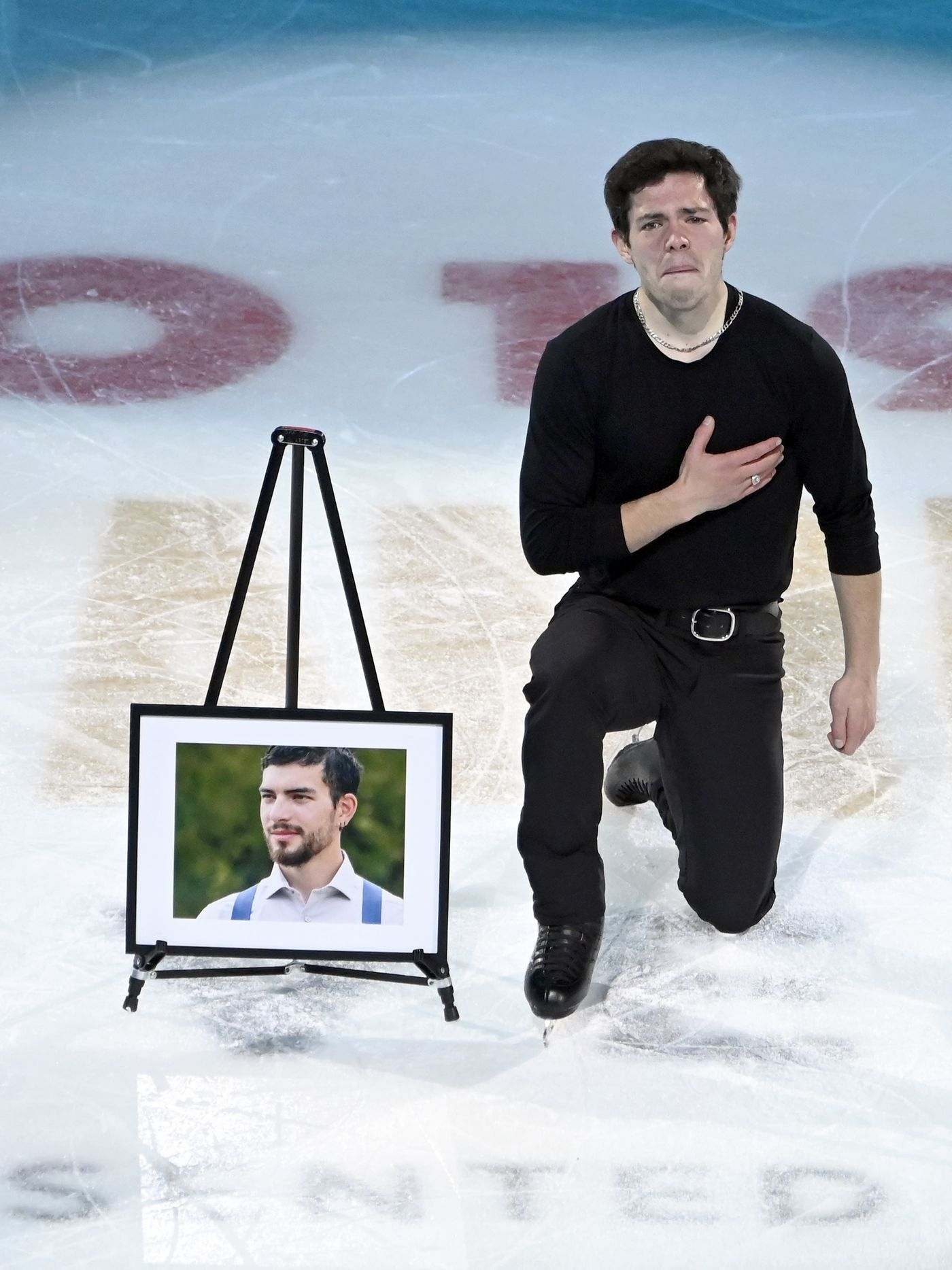 Keegan Messing, right, of Canada, performs for his late brother Paxon during the International Skating Union Grand Prix of Figure Skating Series exhibition Sunday, Oct. 20, 2019, in Las Vegas. (AP Photo/David Becker)