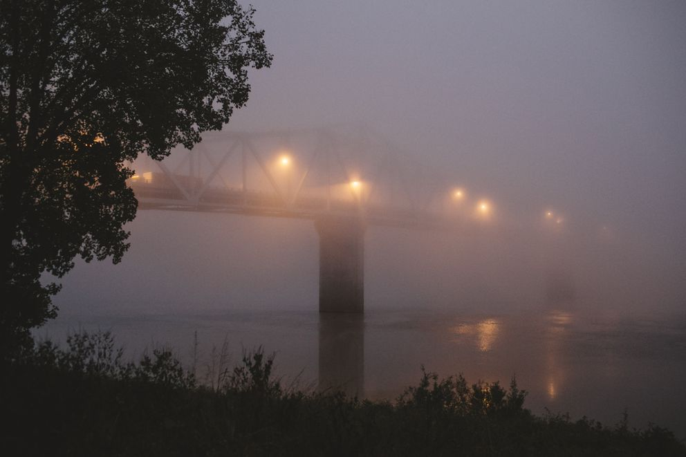 A fog-shrouded bridge over the Ohio River in Madison, Ind., Oct. 13, 2017. Madison has been hit especially hard by the opioid crisis, contributing to a suicide rate three times the national average. Those young adults and teenagers, even middle schoolers, who killed themselves in the past few years have left behind unanswerable questions. (Andrew Spear/The New York Times)